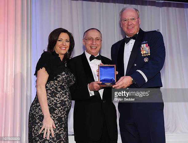 News Anchor Kyra Phillips Steve Scheffer and Chief of the National Guard Bureau General Craig R McKinley pose onstage at the 49th USO Armed Forces...