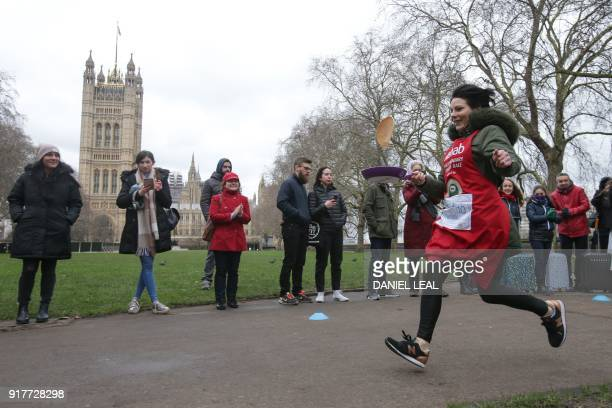ITV News anchor Lucrezia Millarini takes part in the annual Parliamentary Pancake Race in front on the Houses of Parliament in central London on...