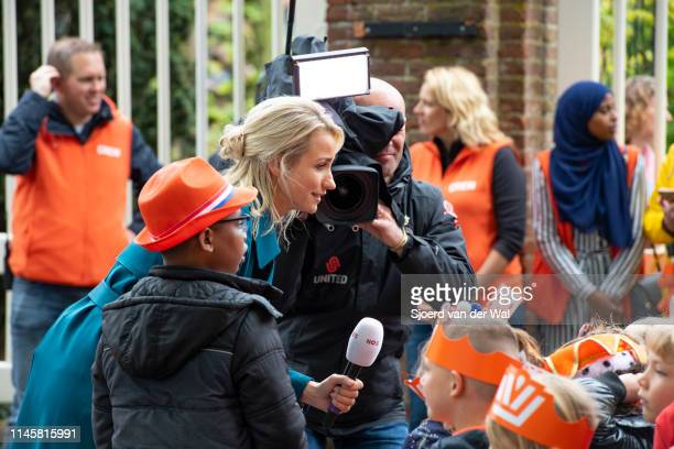News anchor of the NOS Dionne Stax interviewing children who are waiting for the arrival of the Royal Family on April 27 2019 in Amersfoort...