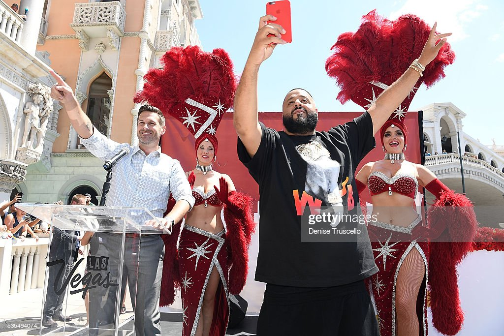 FOX5 news anchor Sean McAllister, DJ Khaled, Las Vegas showgirls Jennifer Aurty and Porsha Revesz during the ceremony presenting DJ Khaled a key to the Las Vegas strip and the launch of official snapchat channel at the Venetian Hotel and Casino on May 29, 2016 in Las Vegas, Nevada.