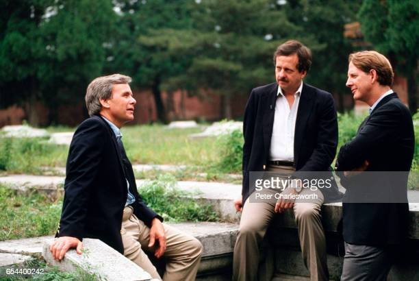 News anchor Tom Brokaw talks with Correspondents George Lewis and Keith Miller in front of the Ming Tombs near Beijing They have just finished taping...