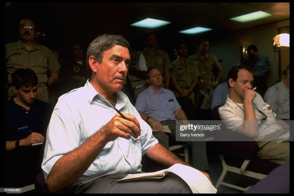 CBS News anchorman Dan Rather (C) among journalists et al being briefed on bd. USS Indespendence, covering gulf crisis spawned by Iraqi invasion of Kuwait (no caps).