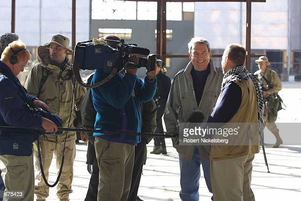 News anchorman Dan Rather interviews US Army soldiers of the 10th Mountain Division December 2 2001 at the Bagram airbase 40 kms north of Kabul...