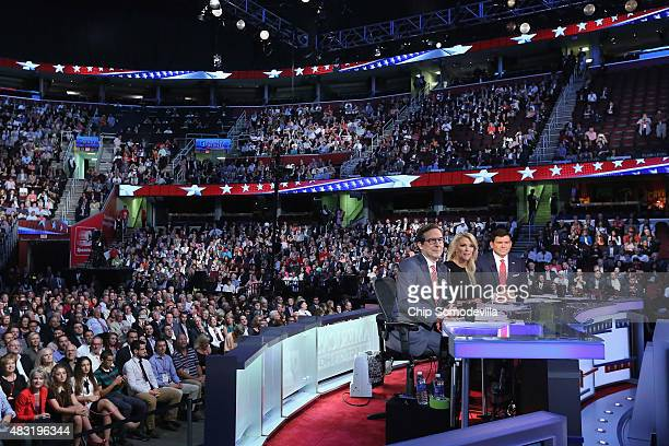 News anchors Chris Wallace Megyn Kelly and Bret Baier prepare to moderate the first primetime Republican presidential debate hosted at the Quicken...