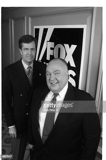 News anchors Roger Ailes and Brit Hume stand together January 14 1997 in Los Angeles CA The anchors gathered for a press event to publicize a new Fox...