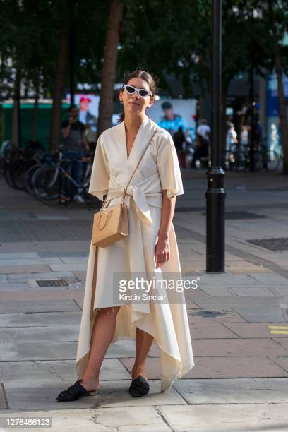 News and Features editor for WWD Natalie Theodosi wears a Medea bag, Mango dress, Mango shoes and Les Specs sunglasses during LFW September 2020 at...