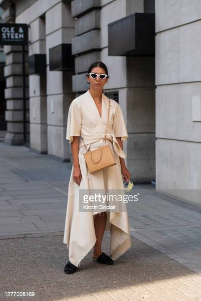 News and Features editor for WWD Natalie Theodosi wears a Medea bag, Mango dress, Asos shoes and Les Specs sunglasses during LFW September 2020 at on...