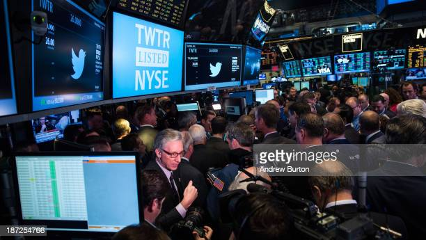 News broadcaster reports live from the floor of the New York Stock Exchange during Twitter's IPO on November 7, 2013 in New York City. Twitter went...