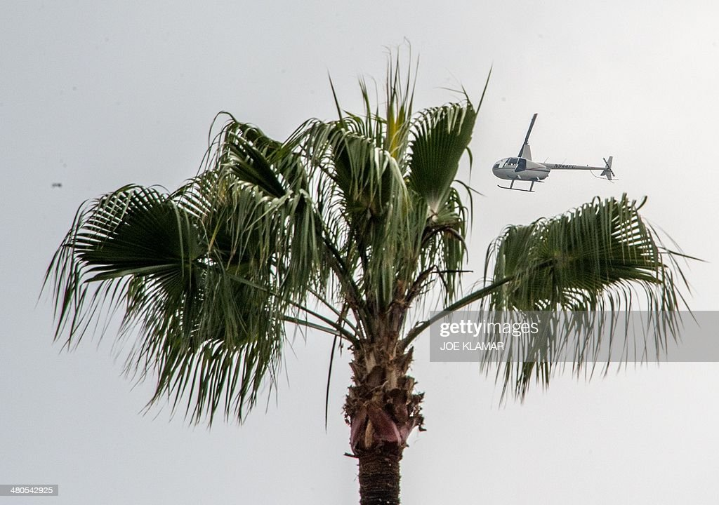 A news chopper flies over Hollywood Forever Cemetery during the funeral of Mick Jagger's girlfriend LWren Scott in Hollywood, California on March 25, 2014. The model-turned-fashion designer was found hanged in her luxury New York apartment last week. She was 49. The cemetery was closed for the roughly one-hour service, held amid tight security.