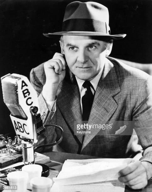 US news commentator drama critic and gossip columnist Walter Winchell making a radio broadcast