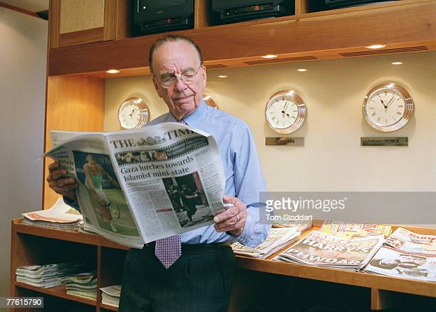 News Corporation Chairman and CEO Rupert Murdoch photographed holding a copy of The Times in his office at News International in Wapping, London.