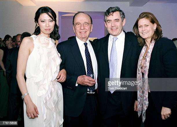News Corporation Chairman and CEO Rupert Murdoch photographed with his wife Wendi and new British Prime Minister Gordon Brown and wife Sarah The four...