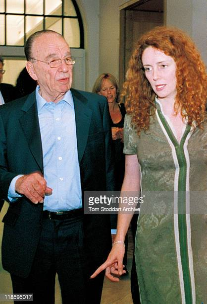 News Corporation Chairman Rupert Murdoch walks with Rebekah Brooks at the National Portrait Gallery where a portrait of Mr Murdoch was unveiled in...