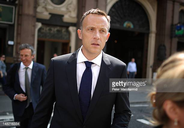News Corporation lobbyist Fred Michel walks to The Royal Courts of Justice to give evidence to The Leveson Inquiry on May 24, 2012 in London,...
