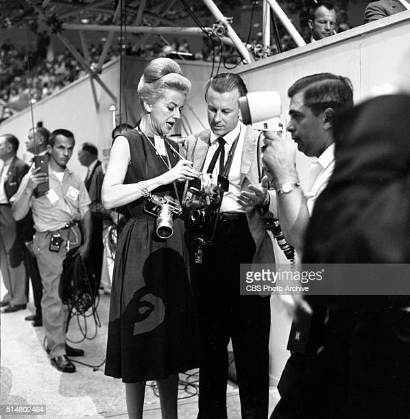 News reports from the 1960 Democratic National Convention, Los Angeles, California CBS News correspondent, Betty Furness, gets some technical advice...