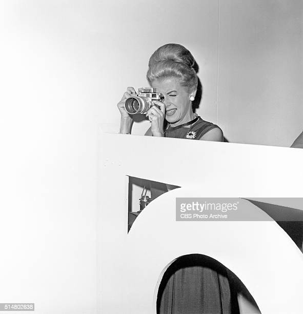 News reports from the 1960 Democratic National Convention, Los Angeles, California CBS News correspondent, Betty Furness, takes some still photos...