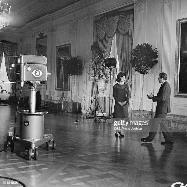 CBS News correspondent Charles Collingwood speaks with American First Lady Jacqueline Kennedy in the East Room of the White House Washington DC...