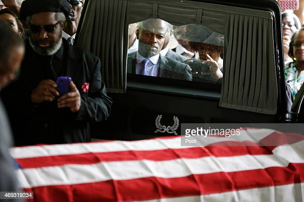 News correspondent Kendis Gibson stands with mourners as the casket of Walter Scott is removed from a hearse for his funeral at WORD Ministries...