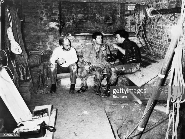 News correspondent Piers Anderton , and NBC News cameraman Peter Dehmel , talk with West Berlin student Dominico Sesta recently, in the basement of a...