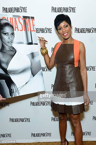 News correspondent Tamron Hall signs her Philadelphia Style Magazine cover enlargement on the red carpet during afternoon tea to celebrate women of...