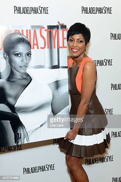 News correspondent Tamron Hall stands with her Philadelphia Style Magazine cover enlargement during afternoon tea to celebrate women of influence at...