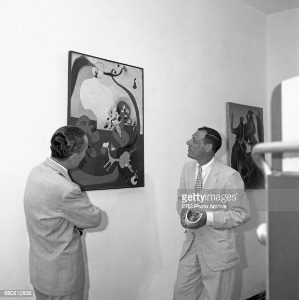 CBS News correspondent Winston Burdett and Thomas Hess executive of Art News discuss the Joan Miró painting Intérieur hollandais II during production...
