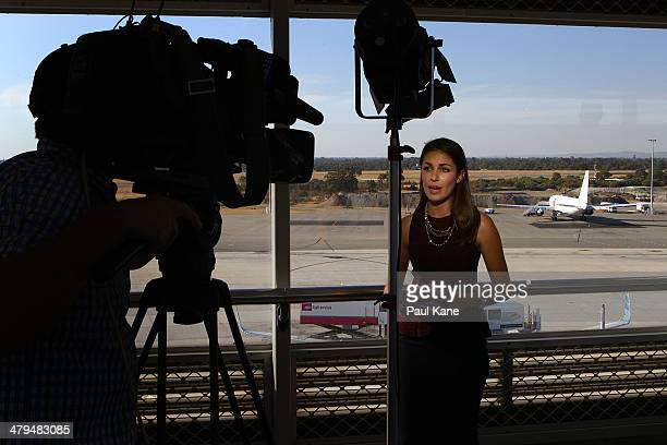 A news crew perform a live cross as the Aeronexus Corporation's Boeing 767 used by the Rolling Stones is parked on the tarmac at Perth international...