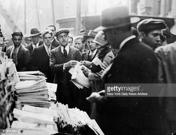 News dealer Morris Bernstein sells papers outside the New York Stock Exchange