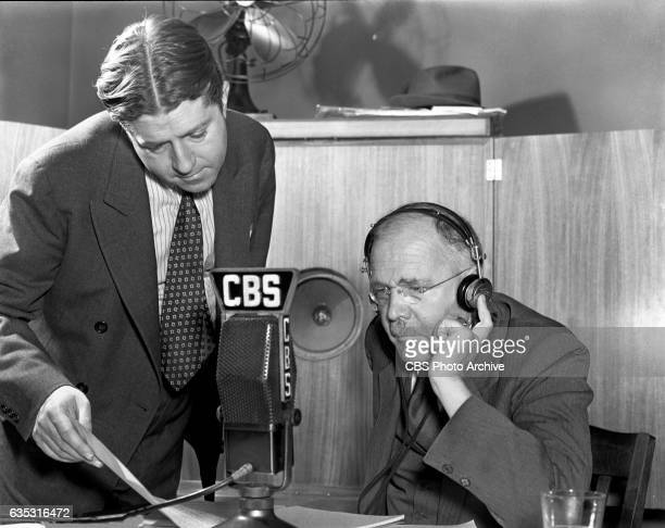News director Paul White left and CBS Radio news commentator and analyst HV Kaltenborn gathers information and delivers reports of the developing...