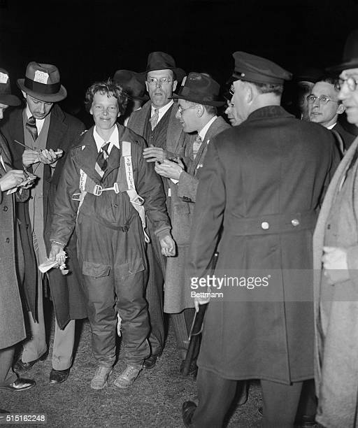 News hawks gather round Amelia Earhart for a word or two from America's premier aviatrix who had just completed a nonstop flight from Mexico City to...