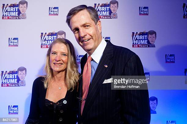News host Brit Hume poses with his wife Kim Hume on the red carpet upon arrival at an event in his honor on January 8 2009 in Washington DC Hume was...
