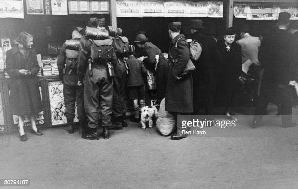 A news kiosk at Paddington Station in London during World War II 23rd May 1942 Original Publication Picture Post 1133 Wartime Terminus pub 1942