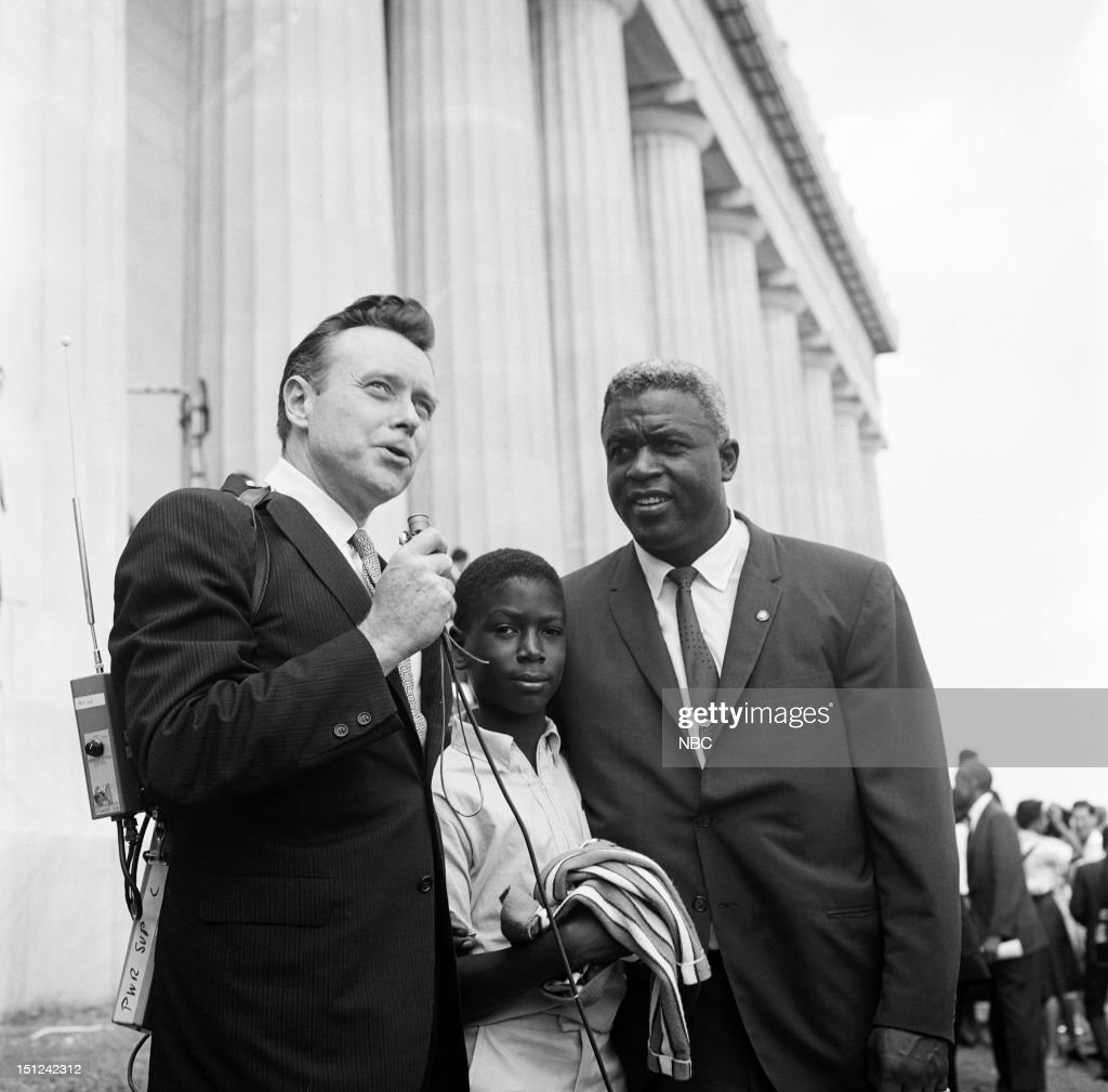 NBC News -- MARCH ON WASHINGTON FOR JOBS AND FREEDOM 1968 -- Pictured: (l-r) NBC News' Merrill 'Red' Mueller, son David Robinson, baseball player Jackie Robinson during an interview at Lincoln Memorial during the March on Washington for Jobs and Freedom political rally in Washington, DC on August 28, 1963 --
