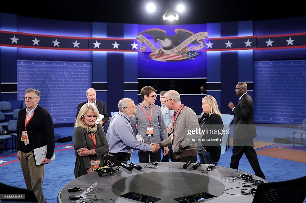 News' Martha Raddatz (2nd L) looks at the desk from where she will co-moderate Sunday night's debate between Republican presidential nominee Donald Trump and Democratic presidential nominee Hillary Clinton at Washington University October 8, 2016 in St Louis, Missouri. The two candidates will face off in a town-hall style debate that will be moderated by Raddatz and CNN's Anderson Cooper.