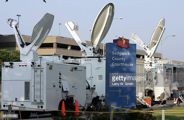 News media satellite trucks from across the country are set up outside the Sedgwick County Courthouse on the first day of the trial of Dennis L Rader...