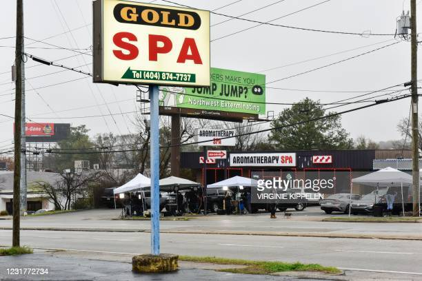 News media set up in front of the Aromatherapy Spa, across the street from the Gold Spa, the day after a gunman shot and killed eight people at three...