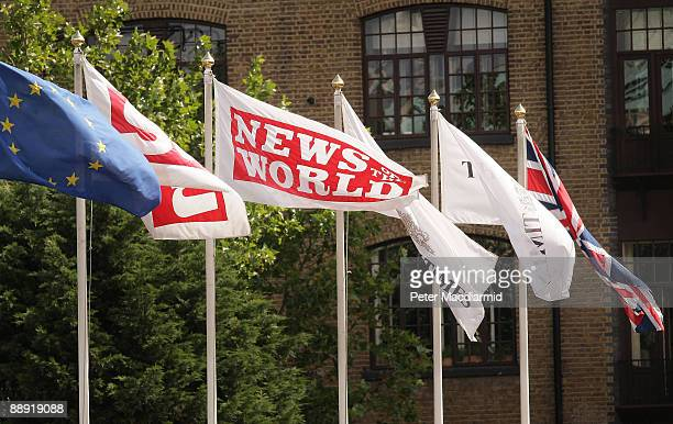 News of The World flag flies amongst others at the News International printing plant at Wapping on July 9 2009 in London The Metropolitan Police are...