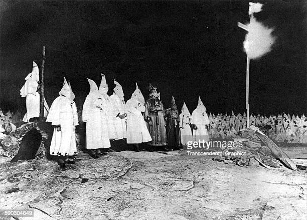News photograph features a large demonstration of Ku Klux Klansmen burning a cross Baltimore Maryland 1923