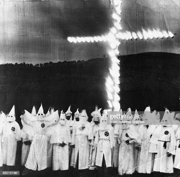 News photograph of a Ku Klux Klan members as they march in full costume Atlanta Georgia circa 1955