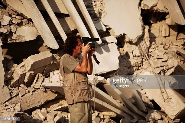News photographer shooting with camera