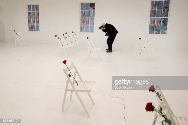 A news photographer takes pictures inside of the First Baptist Church of Sutherland Springs which has been turned into a memorial to honor those who...