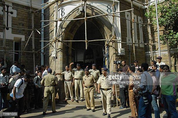 News photographers and TV camermen crowd at the entrance of the Azad Maidan Police Station where the bodyguards of US actress Angelina Jolie were...