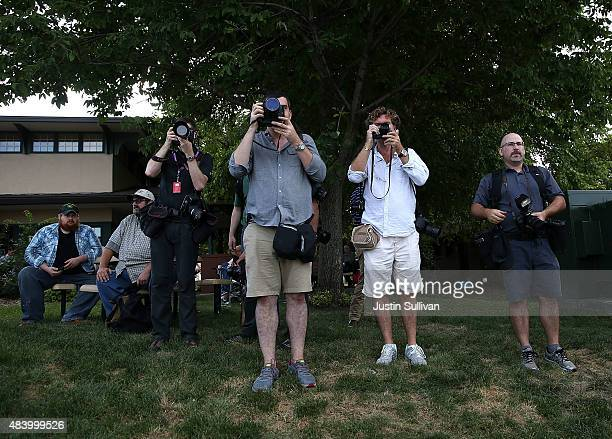 News photographers follow republican presidential hopeful and former Florida Gov Jeb Bush as he makes his way through the Iowa State Fair on August...
