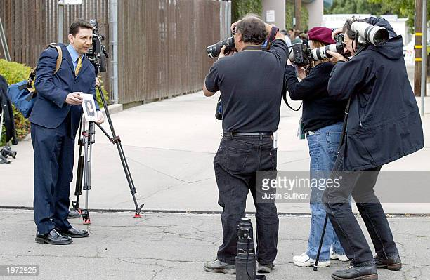 News photographers photograph a program from the memorial service for Laci Peterson and her unborn son Connor May 4 2003 in Modesto California About...