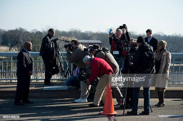News photographers take photographs of Rep John Lewis DGa on the Edmund Pettus Bridge on Saturday Feb 14 2015 Rep Lewis was beaten by police on the...