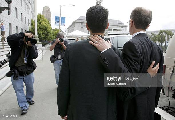 News photographers take photographs of Stewart Gaffney and his gay partner John Lewis as they take a break from a hearing at the California state...