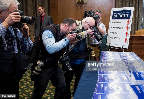 News photographers take photos of the Presidents FY2017 Budget in the Senate Budget Committee hearing room in the Dirksen Senate Office Building on...