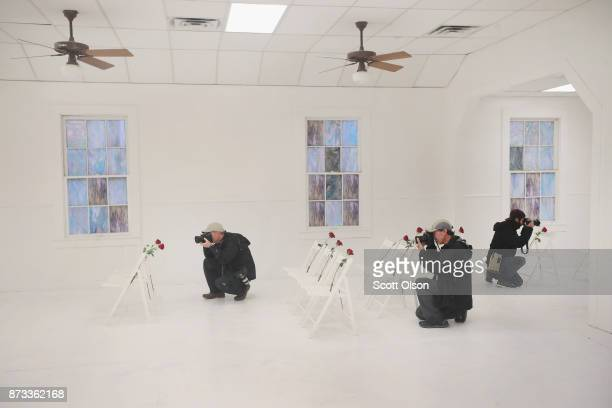 News photographers takes pictures inside of the First Baptist Church of Sutherland Springs which has been turned into a memorial to honor those who...