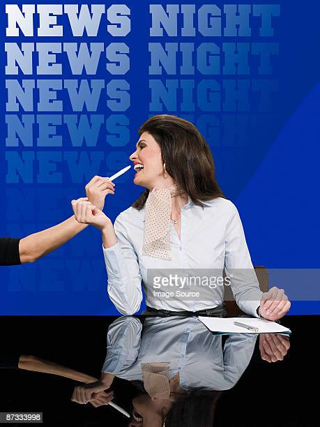 News presenter in make up