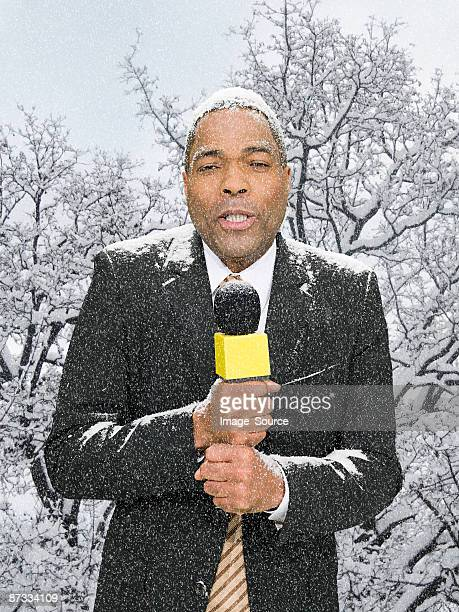 News presenter in snow